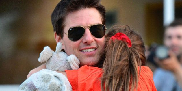 NEW YORK, NY - JULY 17:  Tom Cruise and Suri Cruise leave Chelsea Piers on July 17, 2012 in New York City.  (Photo by James Devaney/WireImage)