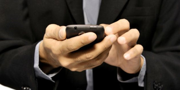 close up of man using mobile...
