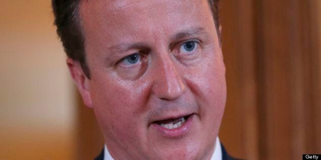 Britain's Prime Minister David Cameron (R) speaks during a joint press conference with his Italian counterpart...