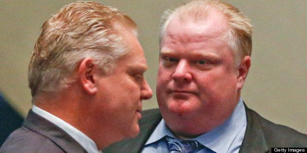 TORONTO, ON - FEBRUARY 20: Councillor Doug Ford and Mayor Rob Ford chat in council chambers during a...