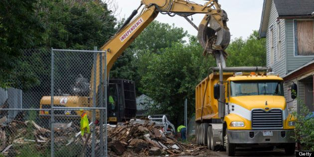 CLEVELAND, OH - AUGUST 7:  Demoliton crews clean up the remains of Ariel Castro's home after it was torn down on August 7, 2013 in Cleveland, Ohio. The State of Ohio leveled Castro's home less than one week after Castro was sentenced to life in prison with no parole plus one thousand years for abducting three young women between 2002 and 2004. The women escaped this past May. (Photo by Angelo Merendino/Getty Images)