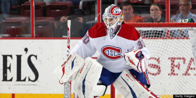 PHILADELPHIA, PA - APRIL 03: Peter Budaj #30 of the Montreal Canadiens tends goal during warm-ups prior...