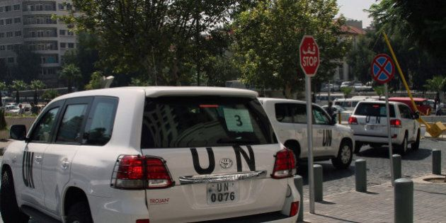 A convoy of United Nations (UN) vehicles leave a hotel in Damascus on August 26, 2013 carrying UN inspectors...