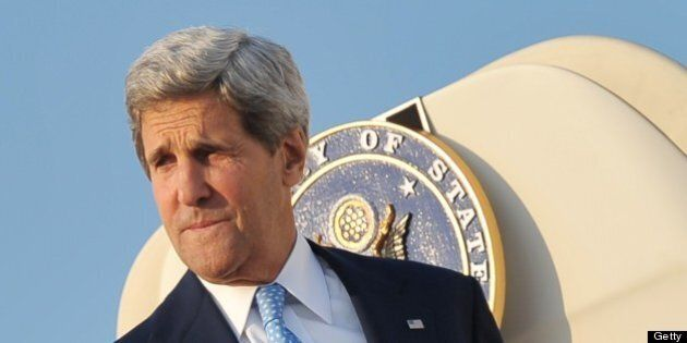 US Secretary of State John Kerry makes his way to board a plane on July 15, 2013 at Andrews Air Force...