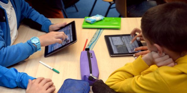Pupils use tablets during courses in a classroom at the Leonard de Vinci 'connected' middle school in...
