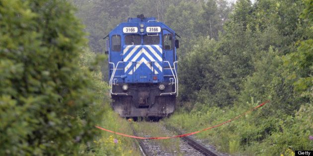 A train from the MMA (Montreal, Maine & Atlantic) railway is viewed as it was stopped by the RCMP and considered as a piece of evidence on July 9, 2013 near Lac -Megantic, Quebec. According to the owners of the train that leveled Lac-Mégantic, the simple rupture of a fuel or oil line, the fourth such rupture on a Montreal, Maine & Atlantic locomotive in the last eight years, may have been all that was needed to set in motion one of the most devastating rail disasters in Canadian history. Either way, both veteran railroaders and locals are disputing company assertions that local firefighters powering down a locomotive in order to put out a small fire was all it took to send 73 oil cars hurtling towards Lac-Mégantic. AFP PHOTO/STEEVE DUGUAY        (Photo credit should read STEEVE DUGUAY/AFP/Getty Images)