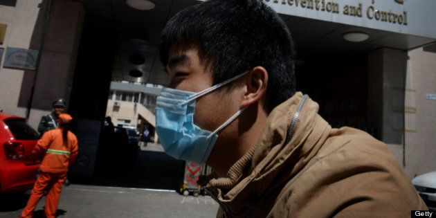 A Chinese man arrives at the Beijing Center for Disease Prevention and Control as the country deals with the H7N9 bird flu virus on April 18, 2013.  China has confirmed a total of 82 human cases of H7N9 avian influenza since announcing about two weeks ago that it had found the strain in people for the first time. Health authorities in China say they do not know exactly how the virus is spreading, but it is believed to be crossing to humans from birds, triggering mass poultry culls in several cities.      AFP PHOTO/Mark RALSTON        (Photo credit should read MARK RALSTON/AFP/Getty Images)