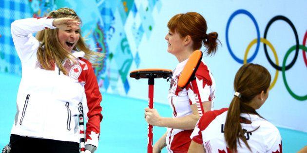 SOCHI, RUSSIA - FEBRUARY 19: Jennifer Jones of Canada celebrates with teammate Dawn McEwen after defeating...