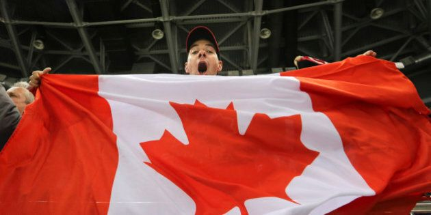 Sochi, Russia - February 12 - SSOLY- Canadian fan Edward Cowie celebrates the Canadian victory.At the...