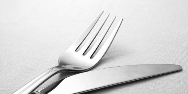 fork and knife on a napkin on...