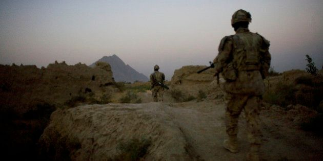 Canadian soldiers with the 1st RCR Battle Group, the Royal Canadian Regiment, patrol before sunrise in the Panjwaii district, near Salavat, southwest of Kandahar, Afghanistan, Thursday, Sept. 9, 2010. (AP Photo/Anja Niedringhaus)