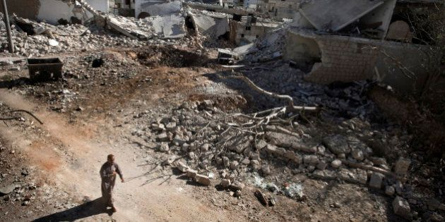 A man walks through a destroyed residential area of the Syrian city of Saraqib, southwest of Aleppo, on September 9, 2013, following repeated airstrikes by government forces' fighter jets. US President Barack Obama and his Russian counterpart Vladimir Putin discussed the idea of placing Syrian chemical weapons under international control at last week's G20 summit in Saint Petersburg, Putin's spokesman said on September 10, 2013. AFP PHOTO / GIOVANNI DIFFIDENTI        (Photo credit should read GIOVANNI DIFFIDENTI/AFP/Getty Images)