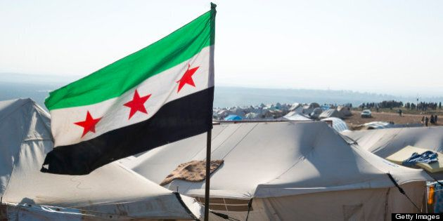 Free Syrian flag flying inside Atimah (Qatma) refugee camp,