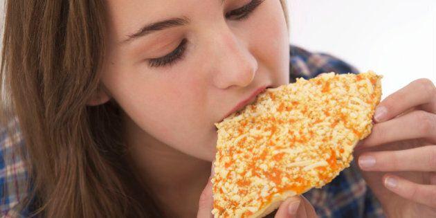 Food Pizza Teenage Girl. (Photo by: Media for Medical/UIG via Getty