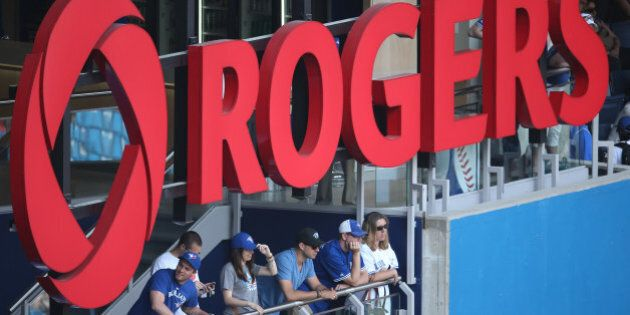 TORONTO, CANADA - MAY 20: Toronto Blue Jays fans watch the game from the outfield standing section under...