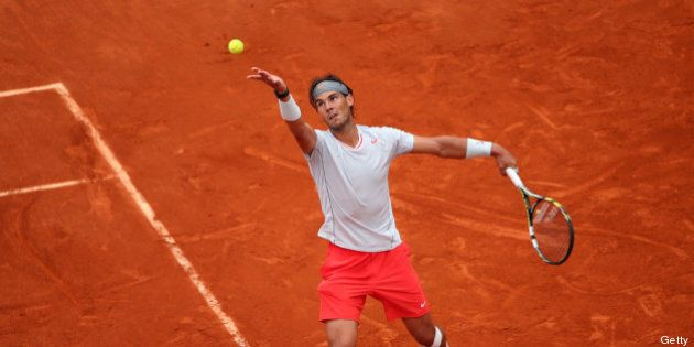 PARIS, FRANCE - JUNE 09: Rafael Nadal of Spain serves during the Men's Singles final match against David...