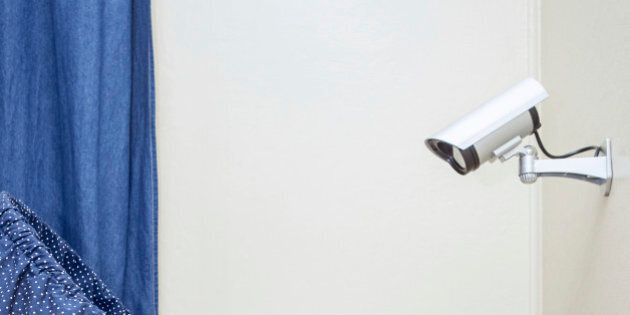 A closed circuit television security camera is mounted on the wall in a babies room monitoring his every...