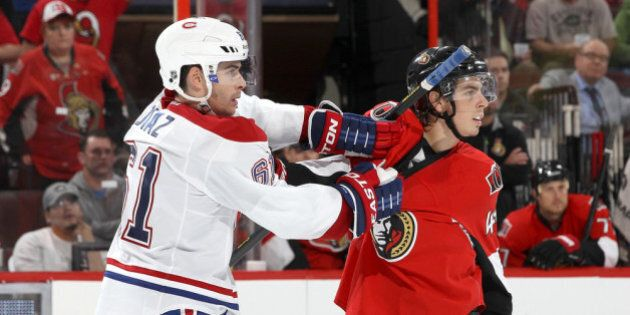 OTTAWA, ON - SEPTEMBER 25: Jean-Gabriel Pageau #44 of the Ottawa Senators is held by Raphael Diaz #61 of the Montreal Canadiens as they watch a fight during an NHL pre-season game at Canadian Tire Centre on September 25, 2013 in Ottawa, Ontario, Canada.  (Photo by Jana Chytilova/Freestyle Photography/Getty Images)