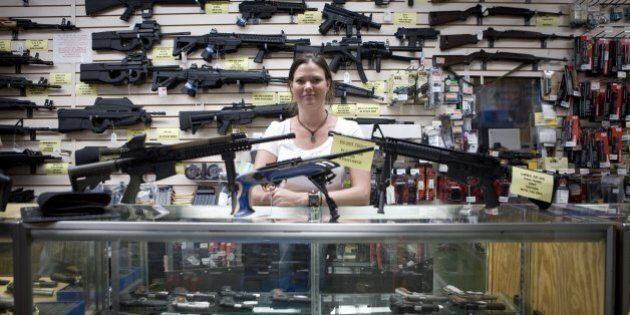 SAN ANTONIO, TEXAS - JUNE 17:  Gina Brewer, the manager Texas Gun, one of the 6,700 gun dealers located near the 2,000 miles long U.S.-Mexico border, insists that she has not sold weapons to Mexican drug cartels representatives, in San Antonio, June 17 2009. Automatic weapons such as AK-47 and AR-15 are purchased in U.S. border states by straw men (paid about $100 per weapons) working for Mexican drug cartels and smuggled into Mexico, where they fuel the narco-violence that has caused over 15,000 death since 2006. In Mexico, where gun sales are illegal, there is only one gun store, solely for police and army supplies. The ATF estimates that 90% of the 23,000 weapons seized in Mexico since 2005 come from the U.S. Following the admission by Secretary of State Hillary Clinton that the U.S. has a responsability in the narco-violence in Mexico (and fearing that it will spill into the U.S.), the ATF, Border Patrol, Homeland Security, ICE, and local police and sheriff are now trying to stem the flow of weapons into Mexico. But surprise check points inspecting vehicules heading South, in spite of hi-tech device like gas tank cameras, are easy to spot for narco-spies, and do little to slow the flow of arms into Mexico. On the Mexican side, Customs are well equiped with machines that can scan entires trucks, but they remain vulnerable to endemic corruption. (Photo by Gilles Mingasson/Getty Images)