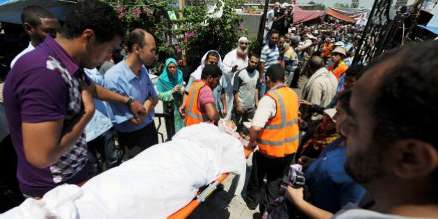 The body of a Muslim Brotherhood protester, shot dead in the Egyptian capital after violence erupted...