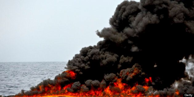 A controlled burn of oil is conducted near the source of the BP Plc Deepwater Horizon oil spill in the...