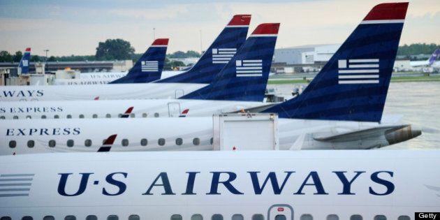 CHARLOTTE, NC - SEPTEMBER 01: U.S. Airways planes sit on the tarmac at Charlotte/Douglas International...