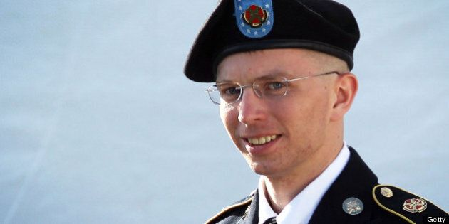 FORT MEADE, MD - JUNE 06: U.S. Army Private Bradley Manning is escorted as he leaves a military court...