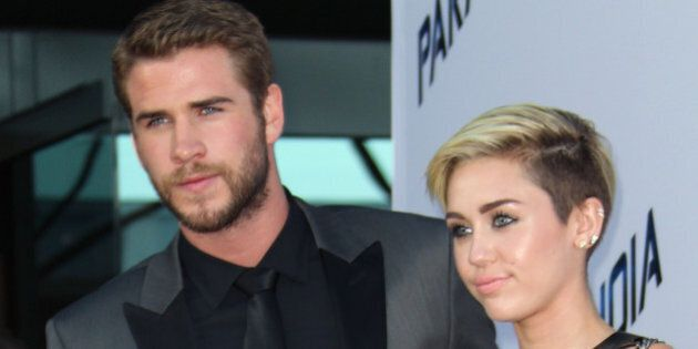 LOS ANGELES, CA - AUGUST 08: Actors Liam Hemsworth (L) and Miley Cyrus attend the premiere of Relativity...