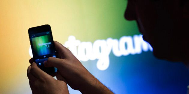 A Facebook Inc. employee demonstrates the new video feature with Instagram during an event at the company's...