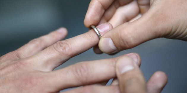 Men exchange rings on September 18, 2012 in Paris. In France, both marriage and adoption will become...
