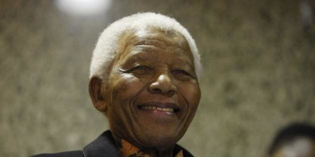 Former South African President Nelson Mandela listens to the State of The Nation address by President...