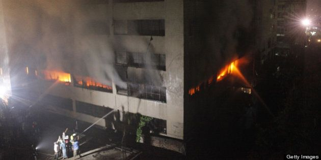 Bangladeshi firefighters attempt to extinguish a blaze at a garment factory in Dhaka early on May 9,...