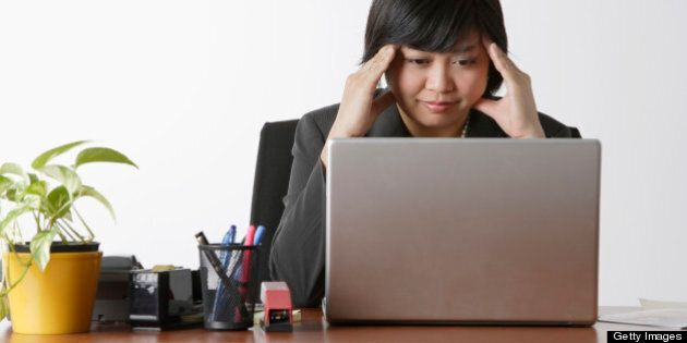 business woman looking stressed at