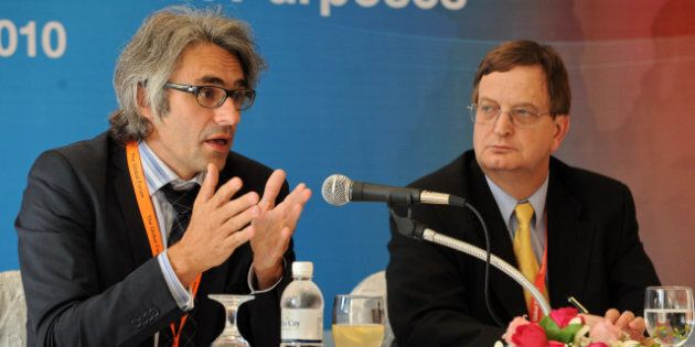 Pascal Saint-Amans (L), head of the Organisation for Economic Cooperation and Development (OECD) global...