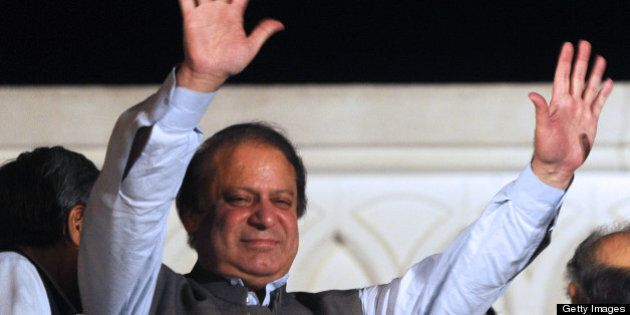 Former Pakistani prime minister and head of the Pakistan Muslim League-N (PML-N) Nawaz Sharif waves to supporters after his party victory in general election in Lahore on May 11, 2013. Sharif declared victory for his centre-right party in Pakistan's landmark elections on May 11, as unofficial partial results put him on course to win a historic third term as premier. The result represented a remarkable comeback for a man who was deposed as premier in a 1999 military coup and came after millions of people defied polling day attacks that left 24 dead to participate in the high-turnout vote. AFP PHOTO / ARIF ALI        (Photo credit should read Arif Ali/AFP/Getty Images)