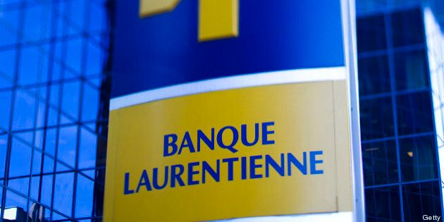 Laurentian Bank of Canada signage is displayed in this photo taken with a tilt-shift lens outside of the company's office in Montreal, Quebec, Canada, on Saturday, Nov. 5, 2011. Canada's dollar depreciated against its U.S. counterpart on concern the debt crisis in Europe is spreading, reducing demand for higher returning assets. Photographer: Brent Lewin/Bloomberg via Getty Images