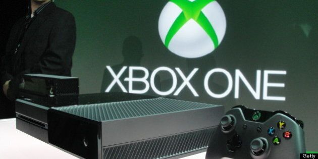 A member of the Microsoft security team watches over the newly unveiled Xbox One videogame console at...