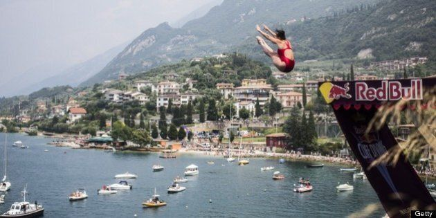 MALCESINE, ITALY - JULY 13:  (EDITORIAL USE ONLY) In this handout image provided by Red Bull, Stephanie de Lima of Canada dives from the 20 metre platform at the Scaliger Castle during the first Red Bull Cliff Diving Women's Competition on July 13, 2013 at Malcesine, Italy. (Photo by Romina Amato/Red Bull via Getty Images)