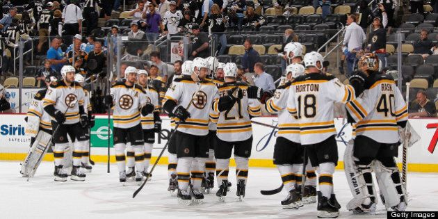 PITTSBURGH, PA - JUNE 3: Tuukka Rask #40 of the Boston Bruins is congratulated by teammates after a 6-1...
