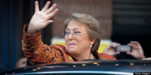 Chilean former president (2006-2010) Michelle Bachelet waves to supporters after a campaign rally for...