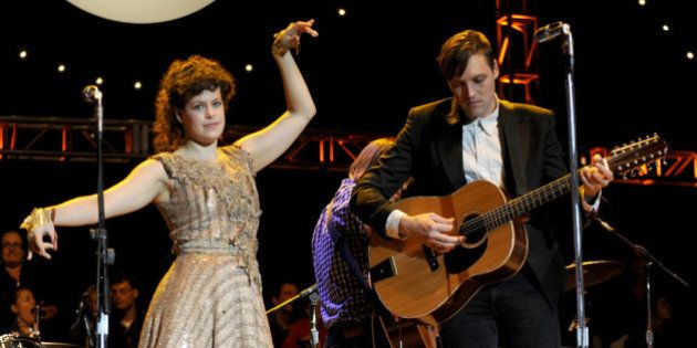 MOUNTAIN VIEW, CA - OCTOBER 22: Régine Chassagne (L) and Win Butler of Arcade Fire perform as part of...