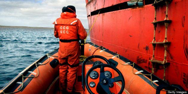 Coast Guard Zodiac moored to Sir Wilfred Laurier, Cambridge Bay, Nunavut