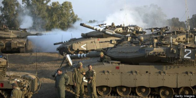 Israeli soldiers are seen with their Merkava tank unit deployed in the Israeli annexed Golan Heights near the border with Syria, on May 6, 2013. UN chief Ban Ki-moon has appealed for restraint after Israeli air strikes on targets near Damascus which prompted Syrian officials to warn 'missiles are ready' to retaliate.   AFP PHOTO/MENAHEM KAHANA        (Photo credit should read MENAHEM KAHANA/AFP/Getty Images)