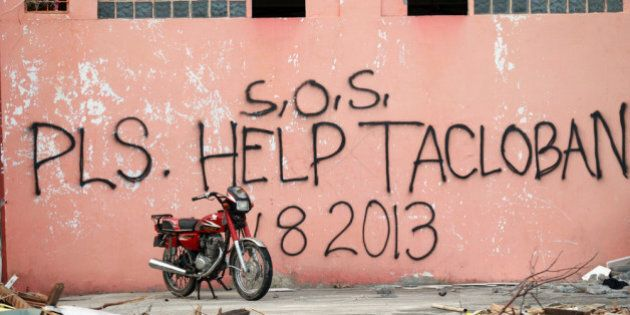 TACLOBAN, PHILIPPINES - NOVEMBER 13: A message seeking help is written on the wall of destroyed building...
