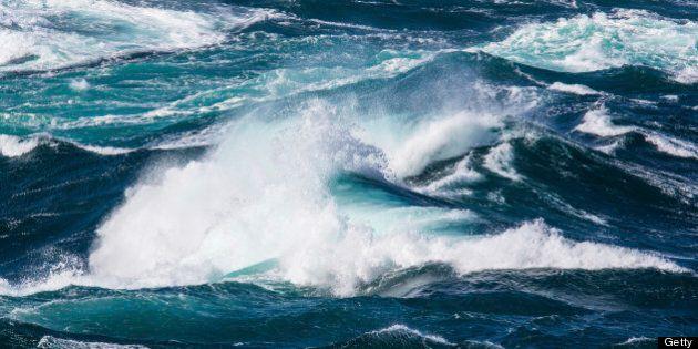 Powerful ocean waves on rocky