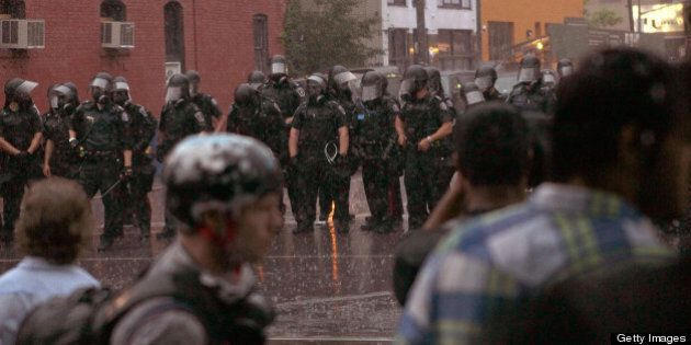 TORONTO, ON - JUNE 27: Police officers hold back demonstrators at the G20 summits June 27, 2010 in Toronto,...