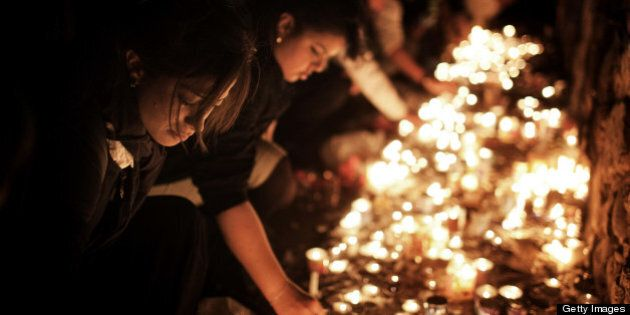 Jewish women light candles at the grave site of Rabbi Shimon Bar Yochai in the northern Israeli village...