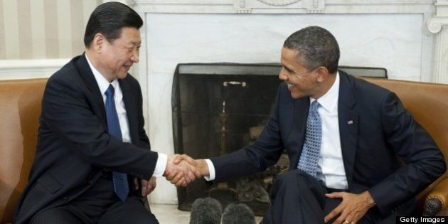 US President Barack Obama shakes hands with Chinese Vice President Xi Jinping during meetings in the...
