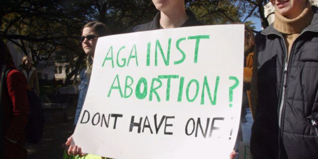AUSTIN, TX - NOVEMBER 24: Students from the University of Texas hold signs during a rally in favor of abortion rights November 24,2003 in Austin, Texas. The rally was organized by students in light of recent national political developments, such as the passage of the 'partial birth abortion' prohibition, and local developments, which include the stoppage of the construction of a Planned Parenthood clinic by pro-life supporters. (Photo by Jana Birchum/Getty Images)