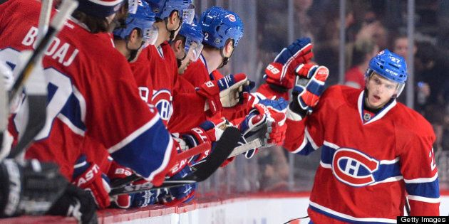 MONTREAL, CANADA - APRIL 15: Alex Galchenyuk #27 of the Montreal Canadiens celebrate a goal with teammates...